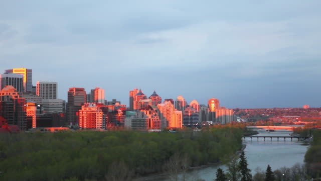 ws pan shot of calgary skyline at sunrise / calgary, alberta, canada - calgary stock videos & royalty-free footage