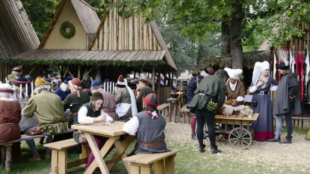 ms shot of camp life at medieval party showing marriage of 1475 with medieval clothing / landshut, bavaria, germany - medieval stock videos & royalty-free footage
