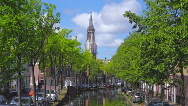 ws shot of canal and nieuwe kerk (new church) in city / delft, south holland, netherlands - south holland stock videos and b-roll footage