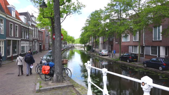 ms shot of canal in city / delft, south holland, netherlands - south holland stock videos and b-roll footage