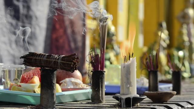 CU Shot of candles and incense burning on altar in shwedagon pagoda / Yangon, Yangon Division, Myanmar