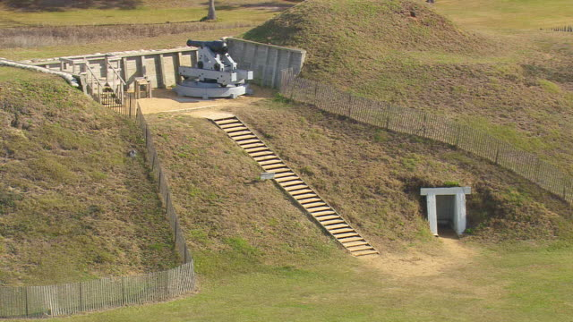 ms aerial shot of cannon at fort fisher / north carolina, united states - tree fort stock videos & royalty-free footage