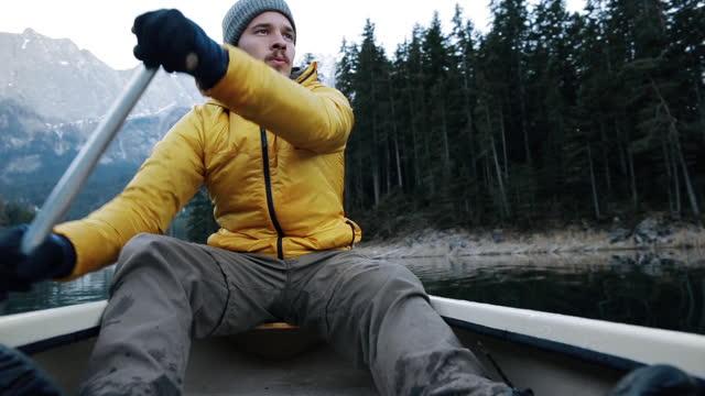 pov shot of canoeist, bavaria, germany - wilderness stock videos & royalty-free footage
