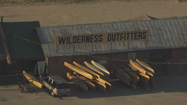 MS AERIAL Shot of canoes outside Wilderness Outfitters store / Ely, Minnesota, United States