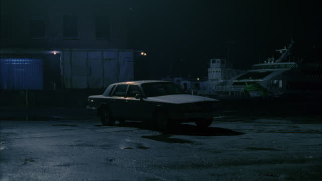vidéos et rushes de ms shot of car at night / unspecified - stationary