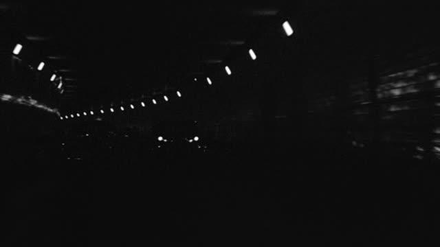 ms pov shot of car driving through hudson tube or tunnel and other period cars on road - back lit bildbanksvideor och videomaterial från bakom kulisserna
