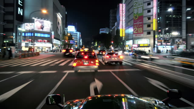 MS T/L POV Shot of car driving through neon lit streets of Shinjuku / Tokyo, Japan