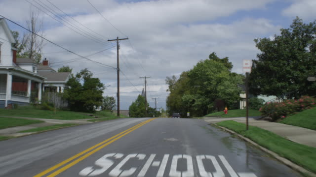 MS POV Shot of car driving through small town / Winchester, Kentucky, United States