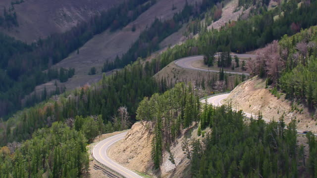 MS AERIAL Shot of car moving on Beartooth Highway / Montana, United States