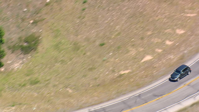 MS AERIALS ZO Shot of car moving on Beartooth Highway / Montana, United States