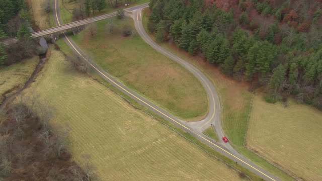 MS AERIAL TS Shot of car moving on Blue Ridge Parkway / North Carolina, United States