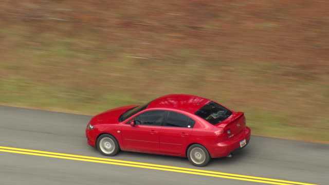MS TS ZI ZO Shot of car moving on Blue Ridge Parkway / North Carolina, United States
