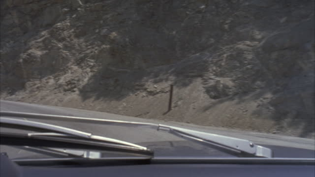 ms pov shot of car passing through mountain highway - vehicle interior stock videos & royalty-free footage