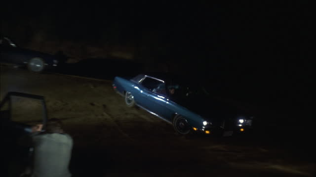 ms ts shot of car running fast and three men firing  - organized crime stock videos and b-roll footage