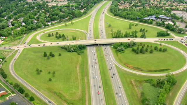 ws aerial td ds shot of car traffic at highway intersection in oakland county / michigan, united state - michigan stock videos & royalty-free footage