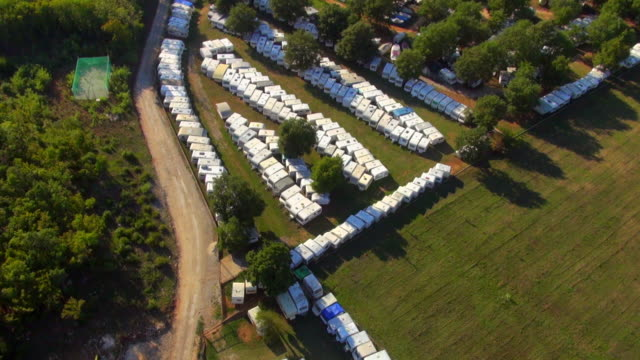 ms aerial shot of caravans stored for winter / porec, istria, croatia - trailer home stock videos & royalty-free footage
