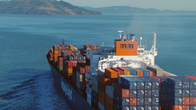 ms aerial shot of cargo ship moving in ocean / oakland, california, united states - container stock-videos und b-roll-filmmaterial