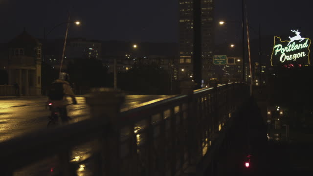 MS Shot of Cars and people cross Burnside bridge into Portland with sign in back side / Portland, Oregon, United States