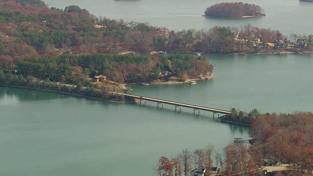 MS AERIAL Shot of cars crossing bridge over lake Keowee / South Carolina, United States