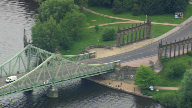 ms aerial shot of cars crossing glienicke bridge on havel river at potsdam / germany - potsdam brandenburg stock videos & royalty-free footage