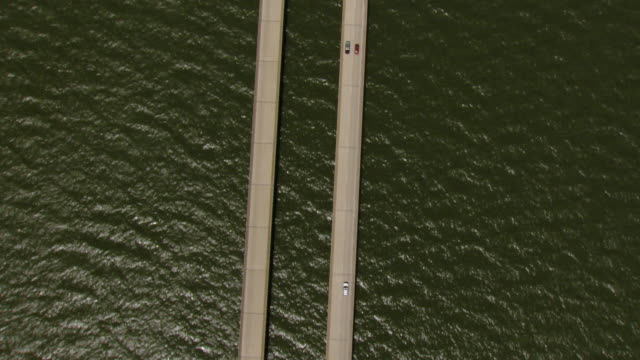 MS AERIAL TS Shot of cars driving on lake pontchartrain causeway over water / Louisiana, United States