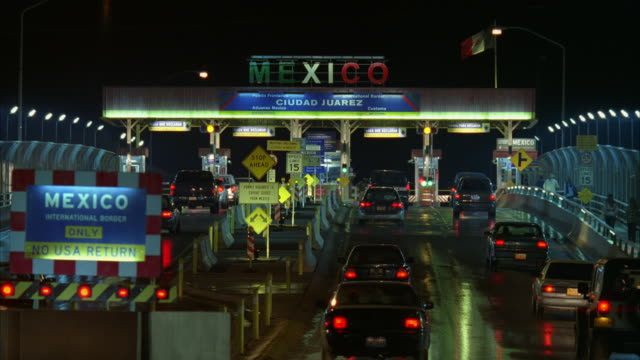 ms r/f shot of cars in line at mexico boarder - geographical border stock videos & royalty-free footage