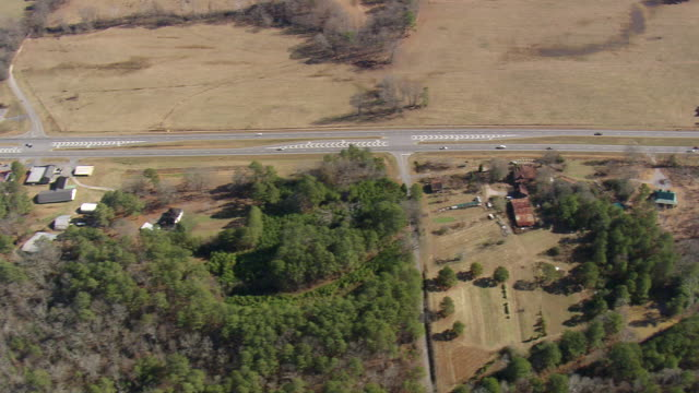 ms aerial ts shot of cars moving on highway 27 / georgia, united states - georgia country stock videos and b-roll footage