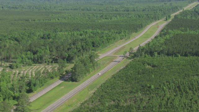 WS AERIAL ZI TS Shot of cars moving on highway 49through Forrest County / Mississippi, United States