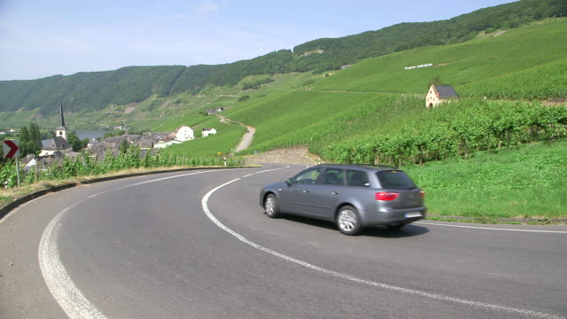 MS Shot of cars moving on street at vineyards near Piesporti Moselle Valley / Piesport, Rhineland Palatinate, Germany