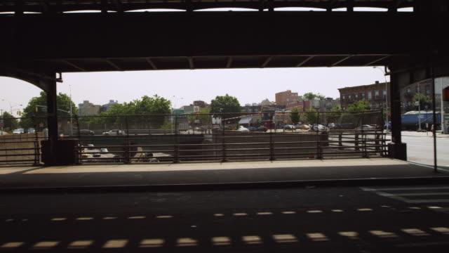 ms pov shot of cars moving on street / new york, united states - butiksskylt bildbanksvideor och videomaterial från bakom kulisserna