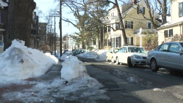 MS Shot of cars parked on snowy street in residential neighborhood / Boston, Massachusetts, United States