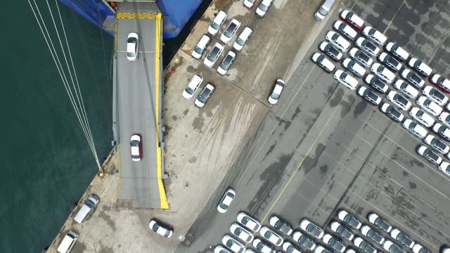 shot of cars running into cargo ship at export pier - abundance stock videos & royalty-free footage