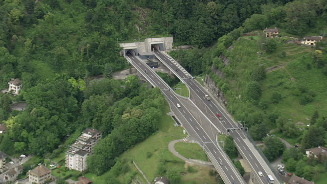 ws aerial zi shot of cars running on highway passing in tunnel, montreux / vaud, switzerland - montreux stock videos and b-roll footage