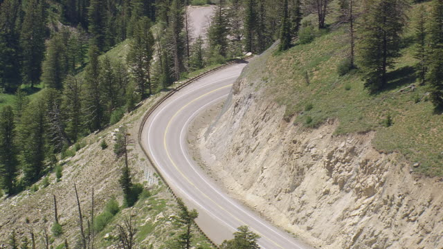 MS AERIAL ZO Shot of cars running on Teton high mountain pass / Wyoming, United States