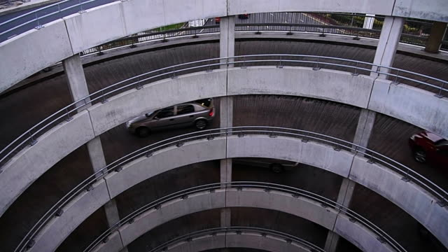 ms ha shot of cars travelling down car park ramp / london, united kingdom  - parking stock videos & royalty-free footage