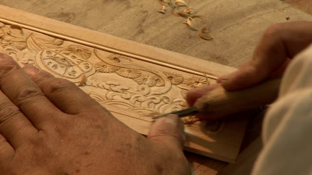 vidéos et rushes de shot of carving and planishing plywood - vue partielle