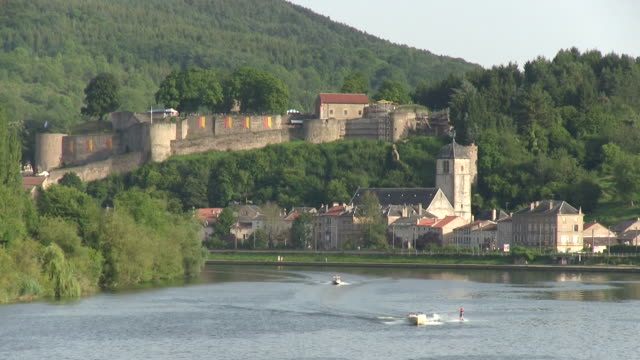 ws shot of castle and river moselle / sierck-les-bains, lorraine, france - lorraine stock videos & royalty-free footage