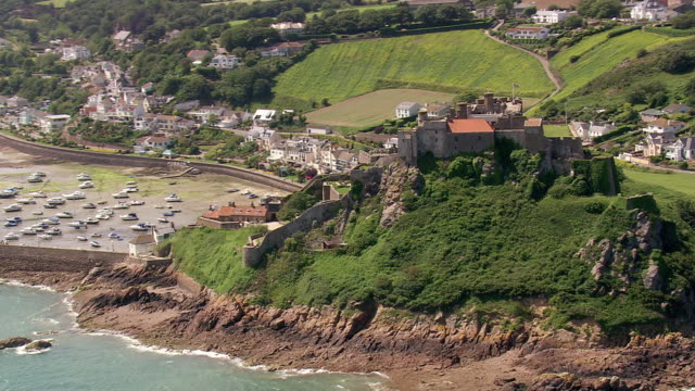 MS AERIAL ZO Shot of castle and sea / Guernsey, Channel Isles