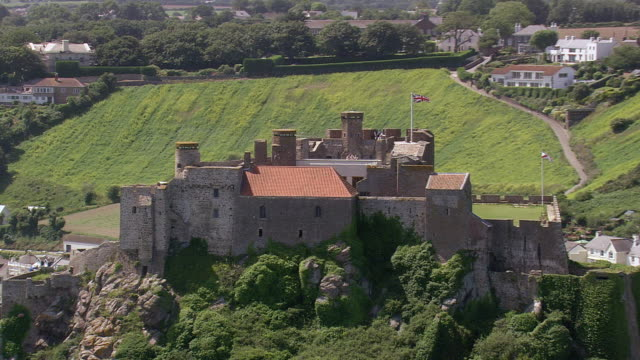CU AERIAL ZO Shot of castle and village / Guernsey, Channel Isles
