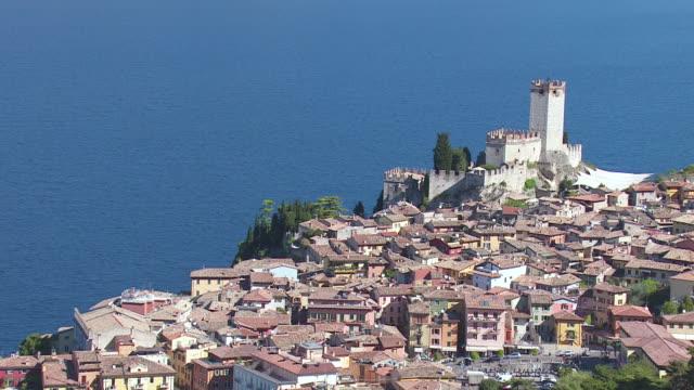 MS AERIAL ZO Shot of castle / Lake Garda, Trentino, Verona, Brescia