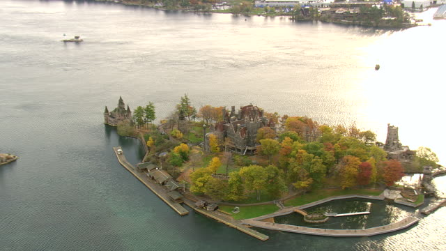 MS AERIAL ZO PAN ZI Shot of castle surrounded by water on Alexandria Bay / New York, United States