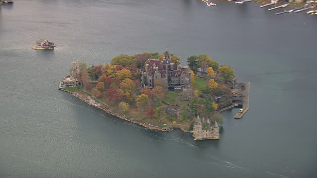 MS AERIAL Shot of castle surrounded by water on Alexandria Bay / New York, United States