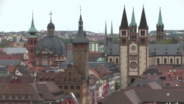 ms shot of cathedral and old buildings in old town / wurzburg, bavaria, germany - wurzburg stock videos and b-roll footage