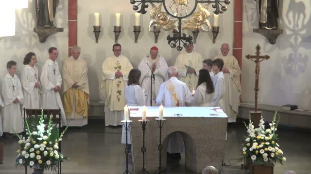 MS Shot of catholic mass at curch St. Marien Saarburg-Beurig, with cardinal Meisner, Cologne / Saarburg, Rhineland Palatinate, Germany