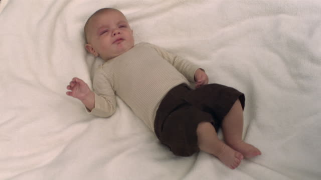 MS SLO MO shot of Caucasian baby boy on blanket, crying / Stanford, Connecticut, United States