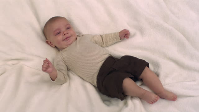 ms slo mo shot of caucasian baby boy on blanket, smiling / stanford, connecticut, united states - baby blanket stock videos and b-roll footage
