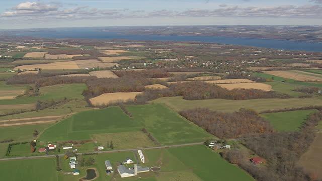 ws aerial pan zi shot of cayuga lake and farmland / new york, united states - cayuga stock videos & royalty-free footage