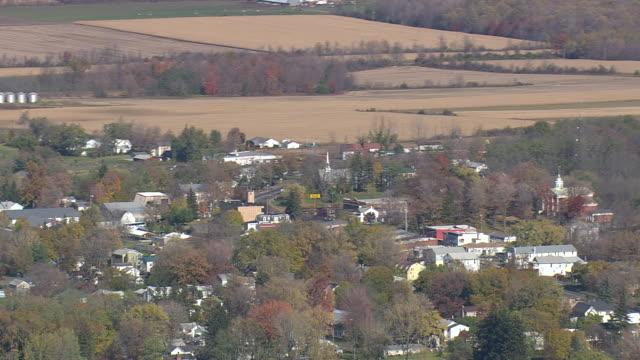 ws aerial zi shot of cayuga lake and farmland / new york, united states - cayuga stock videos & royalty-free footage