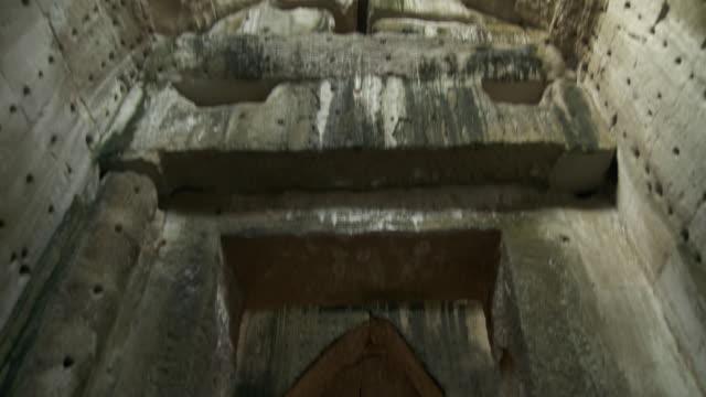 stockvideo's en b-roll-footage met ms td shot of ceiling at buddhist stupa inside central sanctuary of preah khan temple in angkor / siem reap, siem reap province, cambodia - kerktoren