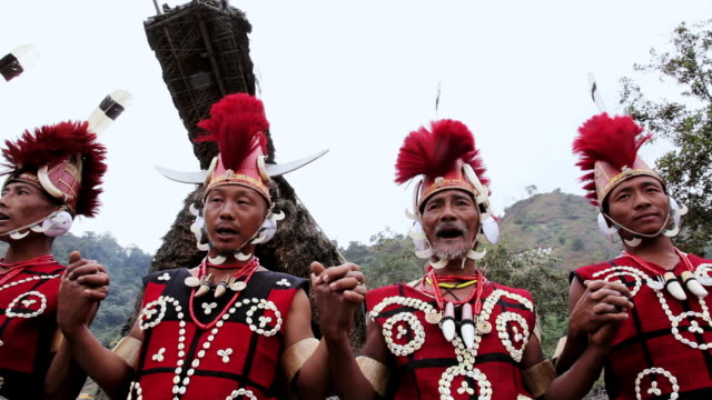 ms pan la shot of chang tribesmen and women faces with wearing traditional costume tribal dancing festival audio / nagaland, india - indigenes volk stock-videos und b-roll-filmmaterial